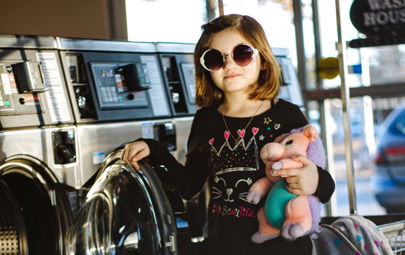 Young customer in laundromat